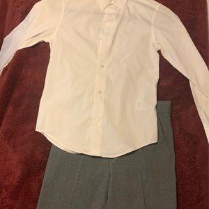Calvin Klein slacks and button up.